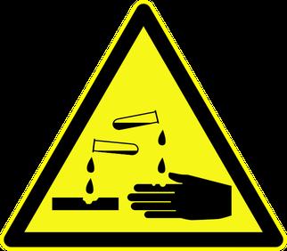 """Warnschild """"Warnung vor ätzenden Stoffen"""" als Symbolbild für den Vortrag Stoffanalyse für Feuerwehren"""
