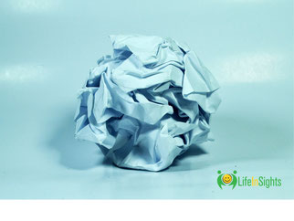 piece of crushed paper relating to mistakes made and unable to take control of life