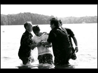Baptism of young man through one of our partners