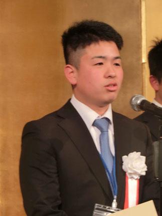 職人心得30か条を披露する佐藤伸吾さん。