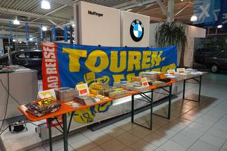 """""""Lesen für einen guten Zweck"""" - Info-Theke der Reiner H. Nitschke Verlags-GmbH im BMW Autohaus Mulfinger/SHA-Michelfeld"""