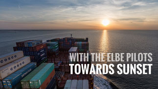 Container ship on Elbe during sunset