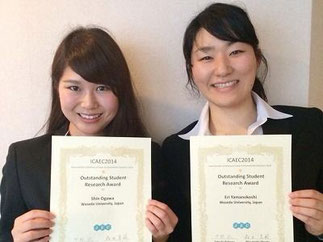 "Ms Shin Ogawa (left) and Ms Eri Yamanokoshi"" with their award certificates"
