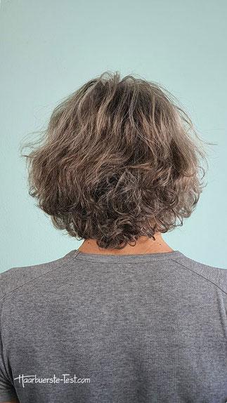 Lockige Haare vor dem Glätten