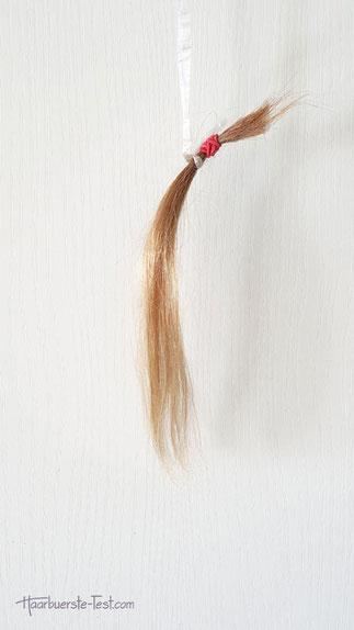 Haarsträhne elektrostatisch entladen