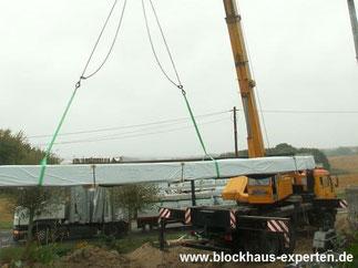 Blockhaus Experten - Entladen von Bündeln bis 3000 kg - Bausatz - Blockhaus bauen - Blockhausbau - Wohnblockhaus - Massivholzhaus