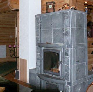Specksteinofen im Blockhaus - Heizung  mit Kaminofen im Wohnblockhaus
