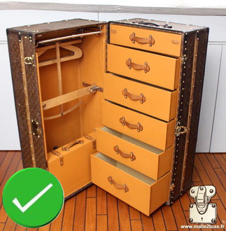 "wardrobe ""theme trunk"", manufactured by Louis Vuitton."