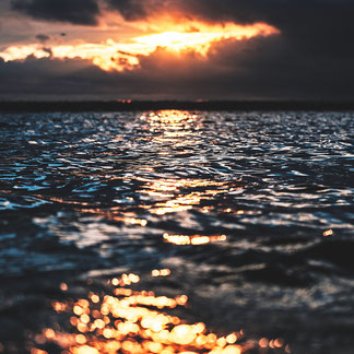 fire water sunset ocean