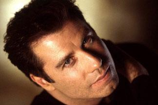 John Travolta, Soleil opposé à Pluton.