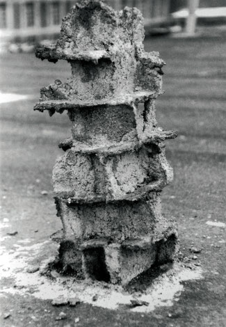 A chimney sculpture made with bricks butter and cement. Birds have eaten butter.