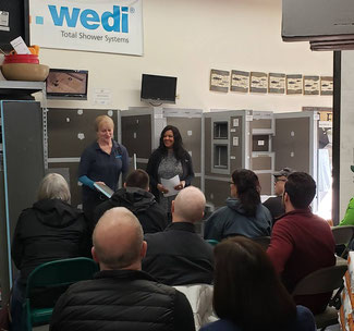 Tile Lines designers Lori and Elizabeth teaching a shower installation class in front of the Wedi shower display in our showroom.