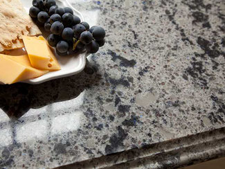 Close up of Cambria Brentwood countertop with a plate of grapes, cheese, and crackers.