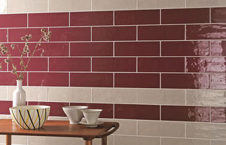 Red and tan ceramic subway tile set in an offset brick pattern.