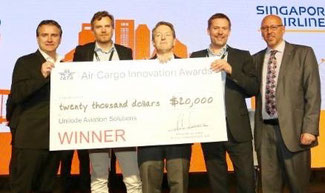 Unilode team along with IATA's Glyn Hughes (far right) receiving the award