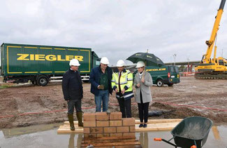 The foundation stone is laid for Ziegler's new freight terminal at BRUcargo  -  company courtesy