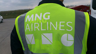 MNG's brand-new logo is displayed on the vest