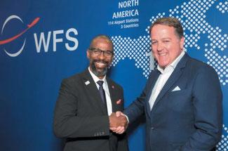 Elliott Paige (left), H-JAIA Director Air Services Development shakes hands with WFS Group CEO, Craig Smyth. Image: WFS