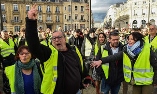 Gilets jaunes protestors in Le Mans, north-west France. Photograph: Jean-François Monier/AFP/Getty Images