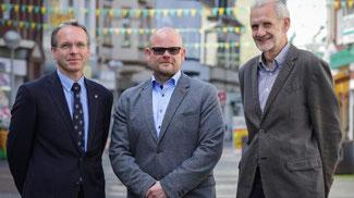 Mitte: Wirtschaftsförderer Stefan Huxel // L: BM André Dora // R: Hans-Jürgen Büker GF der Stadt-Entwicklung // Quelle: DMP 2017