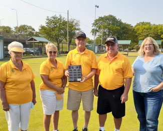 Photo of tournament winners Mary Whitson, Fran Badder, Les Badder and Jerry Meyskens with sponsor Linda Hudson. Les Badder is holding the championship plaque.