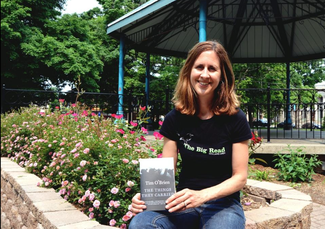 """Hope College English professor Deb Van Duinen holds a copy of Tim O'Brien's """"The Things They Carried"""" Tuesday, June 9, 2015. The book has been chosen as subject of the second """"The Big Read"""" this fall. Amy Biolchini/Sentinel Staff"""