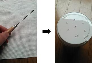 カブトムシの飼育ケースに空気孔を開ける。