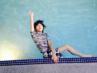 Children can discover creative and fun ways to position the body with the pool wall in the water.
