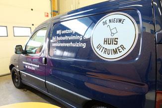 Autobelettering 'de nieuwe huis uitruimer' studiogespuis.nl