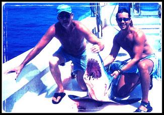 Juan C. Levesque, Fishery Biologist, with a mako shark.