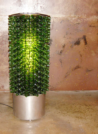 side table lamp fabricated from recycled liquor bottles on stainless steel base with leveling feet