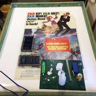 Poster restoration after linen backing- picture: Rodney Ashton
