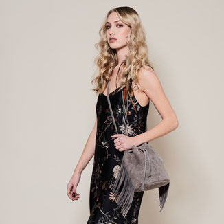 grey bohemian style crossbody suede bag with woven leather