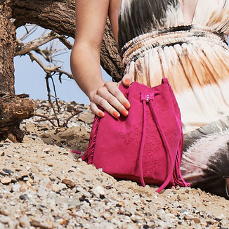 fuchsia western bohostyle crossbody suede bag with woven leather