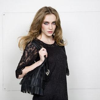 bohomodern style leather black hobo fringe bag with studs