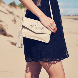 cream bohemian style crossbody leather bag with tassel