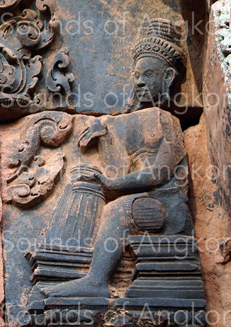 Couple of barrel drums placed vertically and struck by bare hands. Banteay Srei. 11th c.
