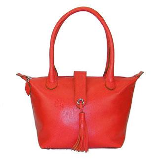sac à main en cuir de veau grainé corail avec pompon fabriqué par un artisan maroquinier
