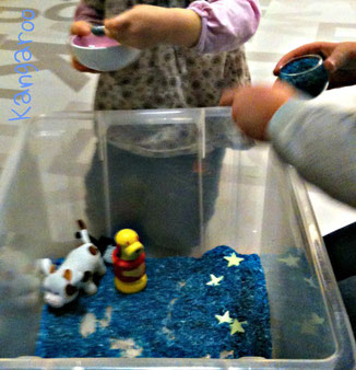 free play with the rice sensory bin