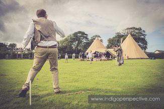 groomsmen play cricket by tipi in north devon wedding photography