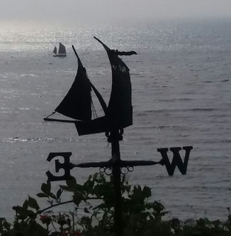 Barnabus arriving in Lamorna Cove to give a 21 gun salute in honour of Adam. The weather vane in the foreground is at Flagstaff Cottage