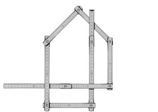 Zollstock zeichnet ein Haus nach