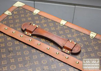 hand-sewn leather handle old trunk