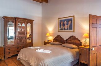 Schlafzimmer in den luxuriösen Suiten und den luxuriösen Doppelzimmern