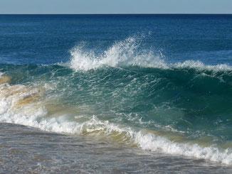 A wave breaking on Coila Beach