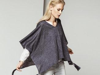 Capes sind vielseitig. Je nach Modell können sie trendy oder edel wirken. Foto: Comma