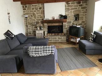 Ferienhaus Coup de Coeur - Wohnzimmer mit Kamin