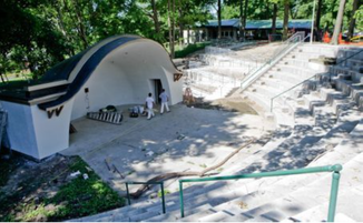 Finishing touches: Renovations on the more than 70-year-old amphitheater in Zeeland's Lawrence Park is in the final stages as landscapers and painters ply their craft. The site will host concerts starting Tuesday. Mark Copier | The Grand Rapids Press