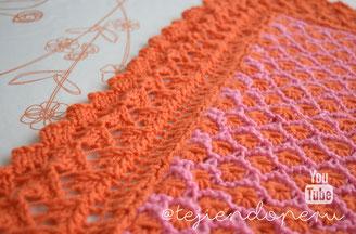 Colcha en 2 colores con borde fantasía tejida a dos agujas o palitos