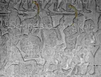 Trompe en forme de C. Victoire de Krishna sur l'Asura Bāna. Angkor Vat. Galerie nord, aile est. XVIe s.